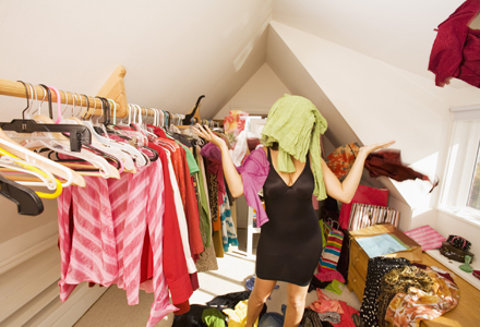 Woman looking for something to wear in closet